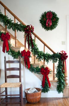 standard and larger estate garland size comparison on banister